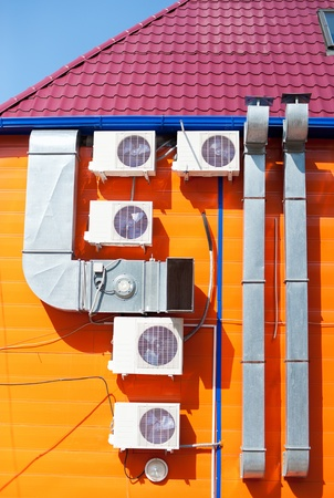 zinked: ventilation tubes and some air conditioners on an outer wall  Stock Photo