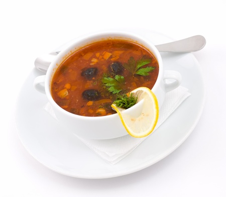 solyanka - a spicy soup of vegetables and meat photo