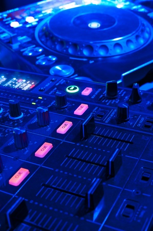 dj tools - audio control console and spin table Stock Photo