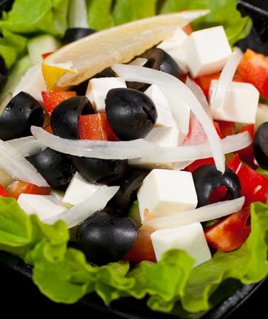 greek salad on lettuce leaves, macro shot