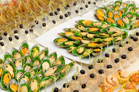 a lot of seafood cold snacks on buffet table, catering photo