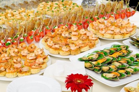 a lot of cold snacks on buffet table, catering