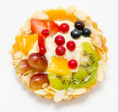 a short pastry basket filled with cream, fruit and berries photo