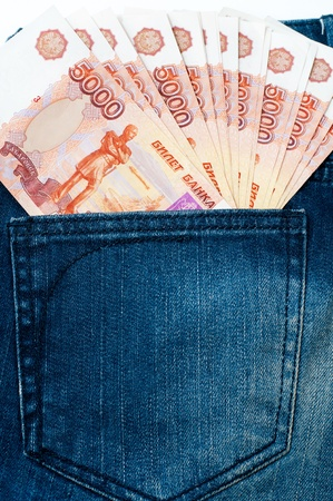 encash: many 5000 rouble bills (the biggest Russian note) in a jeans pocket Stock Photo
