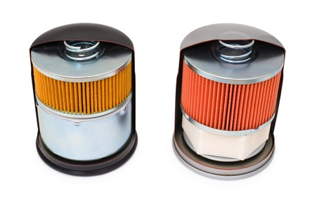 dissect: two oil filters for car engine, in section, demo samples Stock Photo