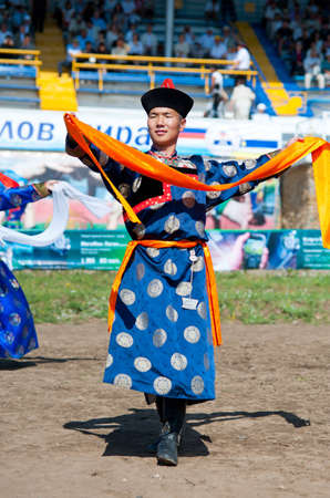 naadan: ULAN-UDE, RUSSIA - JULY 17: The 4th General Session of the World Mongolians Convention, July 17, 2010 in Ulan-Ude, Buryatia, Russia. Dancers open the event with a welcome dance.