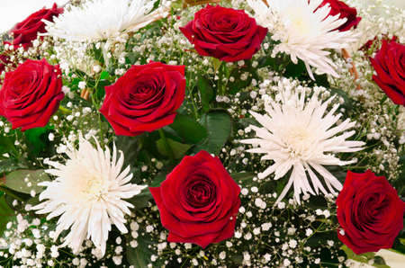 some: a bunch of red roses and white chrysanthemums
