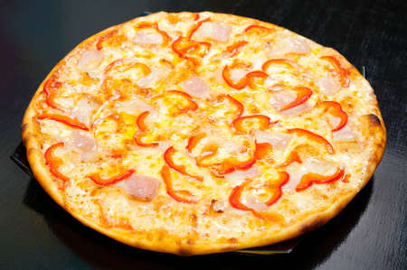a pizza with bacon and bell pepper photo