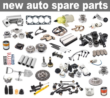 spare car: a lot of new auto spare parts, over white background