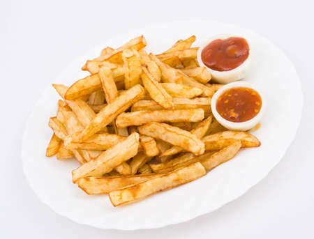 French fried potatoes, served with ketchup in onion halves photo