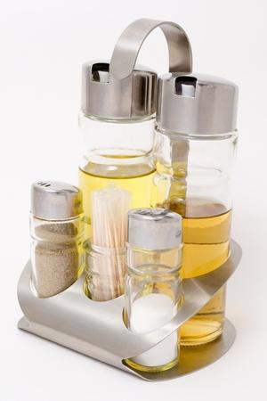 dof: bottles with spices - salt, black  pepper, vinegar and olive oil