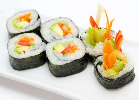 vegetarian sushi rolls with avocado and vegetables photo