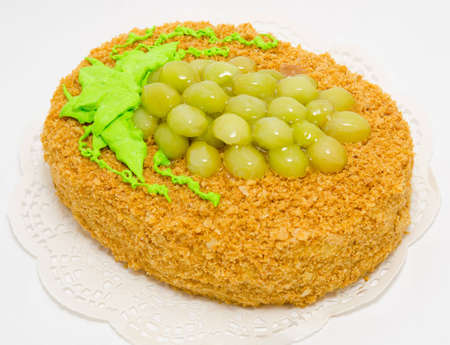 a napoleon cake decorated with grapes and cream Stock Photo