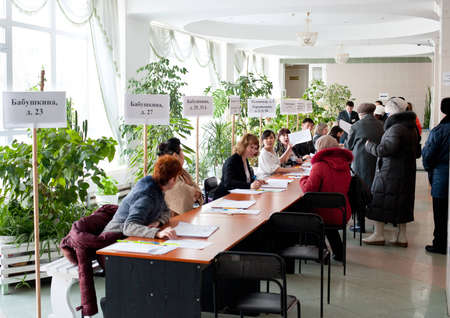 ULAN-UDE, RUSSIA - MARCH 4  The divisional election committee 699 of  Burytia Republic register voters at the presidential election of Russian Federation on March 4, 2012 at a local polling station  Stock Photo - 12533343