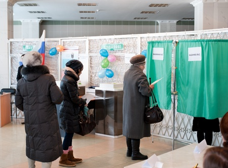 ULAN-UDE, RUSSIA - MARCH 4  Voters at the local polling station 699 stand in line to voting booths at the presidential election of Russian Federation on March 4, 2012 in Ulan-Ude, Buryatia, Russia  Stock Photo - 12533342