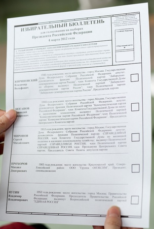 electorate: hands hold a blank ballot for voting at the presidential election of Russian Federation, closeup