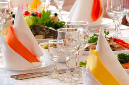 stemware: place setting at a laid restaurant banquet table