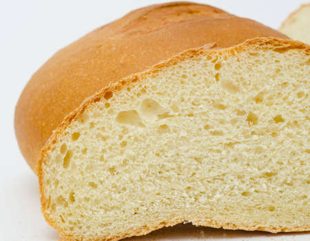 fresh wheat bread - loafs and a round, macro photo