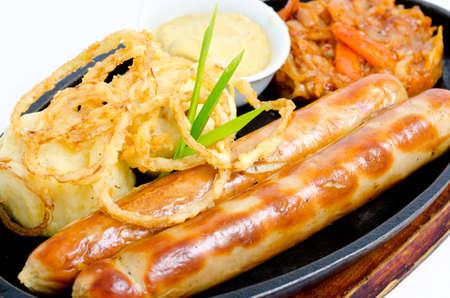 solyanka: grilled frankfurters, potatoes, onion rings in batter, solyanka and mustard
