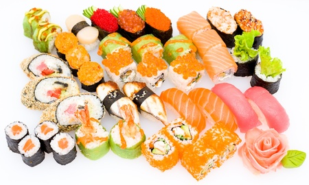 lots of various Japanese sushi, sashimi and sushi rolls