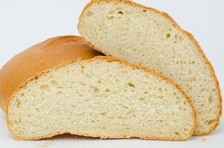 fresh wheat bread - loafs and two rounds, macro photo