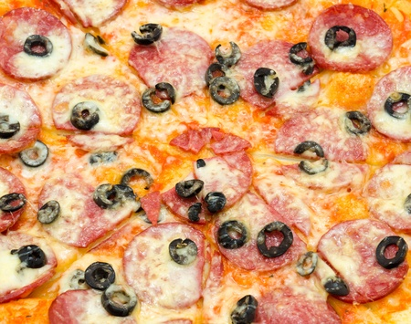 a pepperoni pizza with black olives, a closeup shot Stock Photo - 12944332