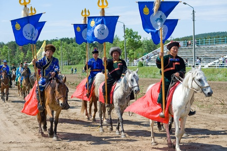 naadan: ULAN-UDE, RUSSIA - JULY 17  The 4th General Session of the World Mongolians Convention, July 17, 2010 in Ulan-Ude, Buryatia, Russia  Riders carry the Convention standards