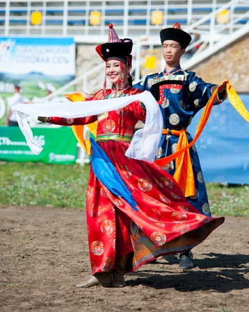 naadan: ULAN-UDE, RUSSIA - JULY 17: The 4th General Session of the World Mongolians Convention, July 17, 2010 in Ulan-Ude, Buryatia, Russia. Unidentified dancers open the event with a welcome dance. Editorial