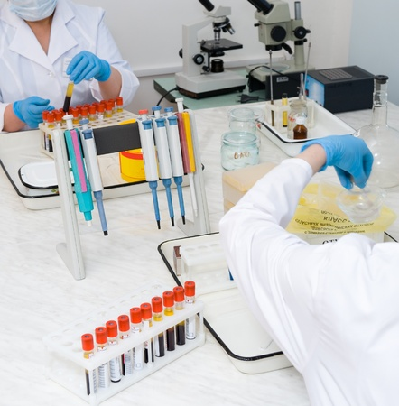 nurses make analysis of blood at a laboratory Stock Photo - 13232858