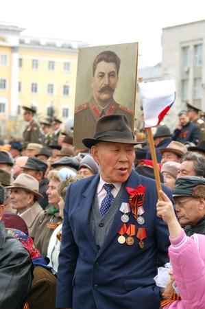 ulan ude: ULAN-UDE, RUSSIA - MAY 9  Unidentified Russian veterans of World War II watch the parade on annual Victory Day, May, 9, 2007 in Ulan-Ude, Buryatia, Russia