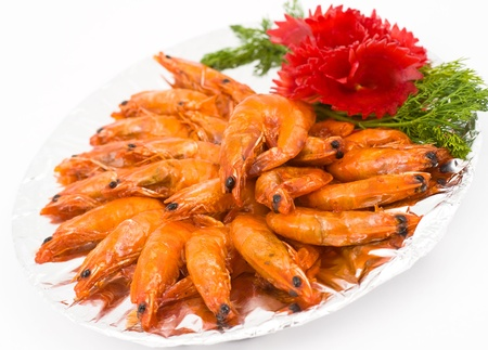 many fresh caramelized shrimps, served with beetroot and dill