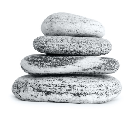 warming therapy: a pyramid of smooth stones, over white Stock Photo