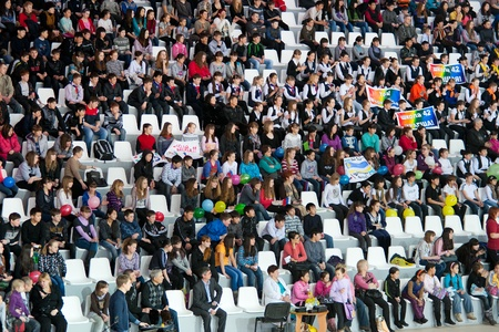 ULAN-UDE, RUSSIA - FEBRUARY 25  This is the opening day of the biggest Siberian sport complex  Numerous fans from city schools support their teams on February 25, 2012 in Ulan-Ude, Buryatia, Russia  Stock Photo - 13315903