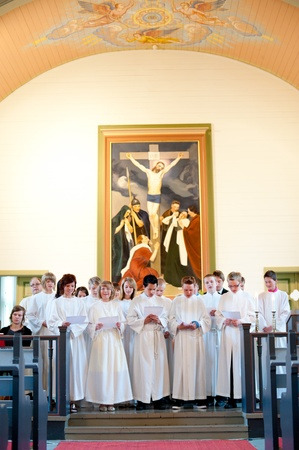 confirmed: VALTIMO, FINLAND - JUNE 19  Fourteen young girls and boys of age 15 are confirmed at the Valtimo Lutheran Church on June, 19, 2011 in Valtimo, Finland  Young participants sing a hymn