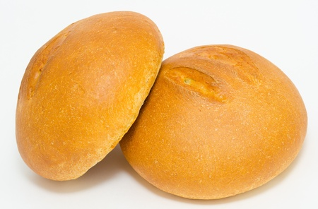 two round loafs of fresh wheat bread photo
