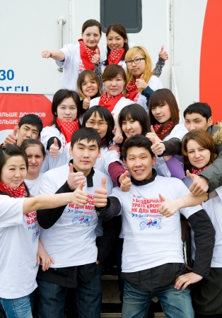 ULAN-UDE, RUSSIA - APRIL 7  City Blood Service makes a promo action for donorship popularization  Young volunteers stand at a mobile hemotransfusion station, April 7, 2010, Ulan-Ude, Buryatia, Russia
