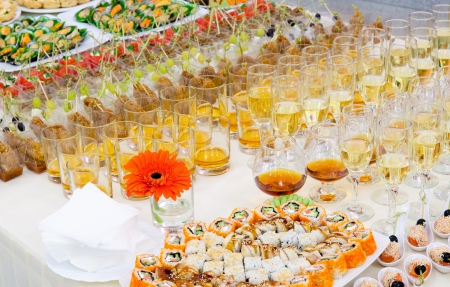 buffet table: a lot of sushi rolls and drinks on buffet table, catering