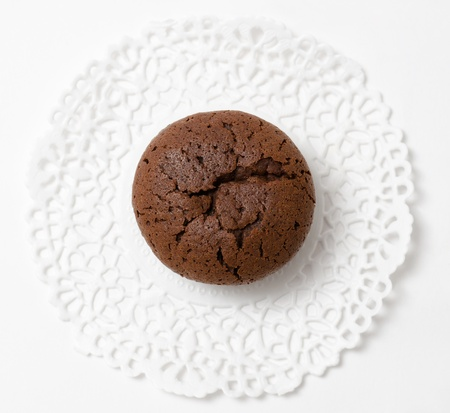 browned: a fresh chocolate muffin  cake , top view Stock Photo