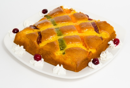 a fresh cake covered with different berry jams photo