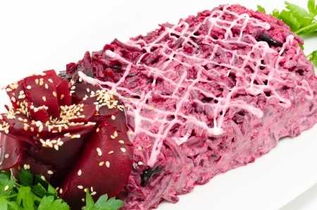 salad of salted herring under grated boiled vegetavles and beetroot photo