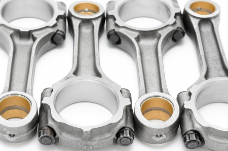 car part: four connecting rods - spare parts of a disel engine Stock Photo