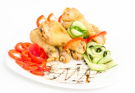 roasted chicken legs served with red pepper and cucumber Stock Photo - 13798418