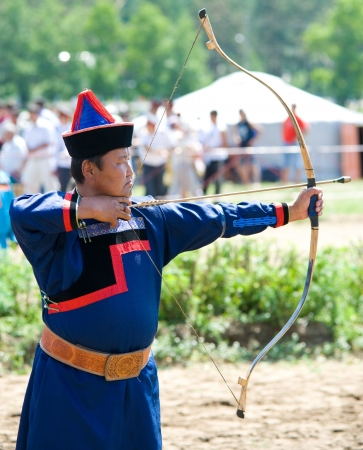 bowman: ULAN-UDE, RUSSIA - JULY 17  The 4th General Session of the World Mongolians Convention, July 17, 2010, Ulan-Ude, Buryatia, Russia  An unidentified archer participates in Mongolian archery competition  Editorial