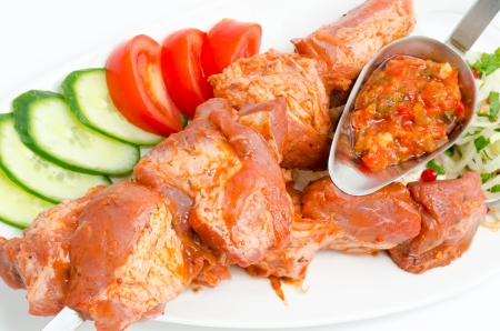 marinate: prepared food for barbecue - seasoned meat with vegetables on skewers
