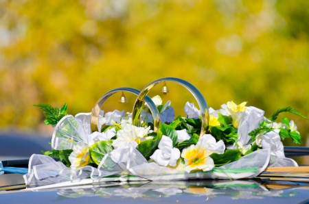 two big rings with bells and flowers as a car wed decoration photo