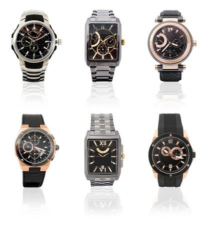 cronógrafo: un conjunto de seis diferentes relojes para hombre de más de blanco Foto de archivo