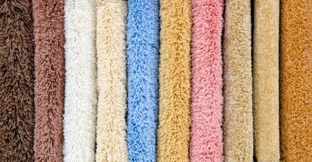 blue carpet: different colourful artificial shaggy carpet samples, closeup