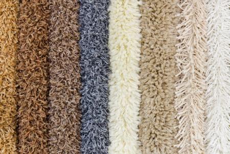 shaggy: different colourful artificial shaggy carpet samples, closeup