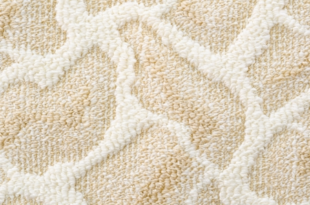 floor covering: a beige floor carpet with a relief pattern