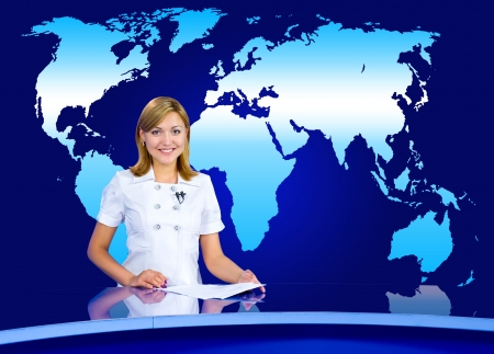 a television anchorwoman at a studio, with a world map in the background
